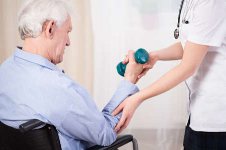 sanitarium: Medical assistance for an elderly person in a wheelchair