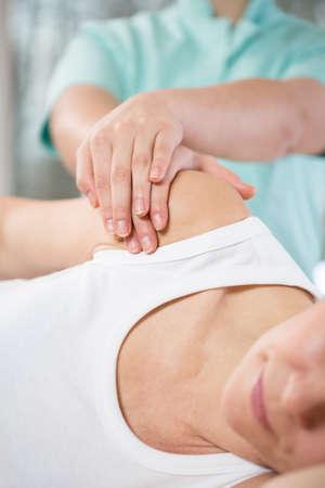 mobilization: Close-up of physiotherapist doing shoulder mobilization