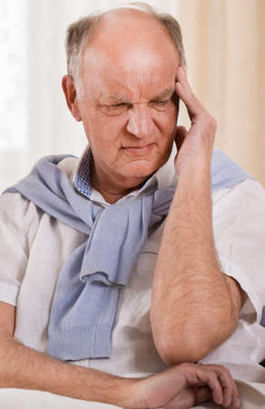 terrible: Photo of senior worried man with terrible headache