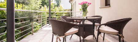 verandah: Round table and wicker armchairs on the verandah Stock Photo