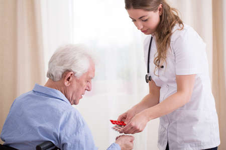 psychotropic medication: Pensioner taking his daily dose of pills