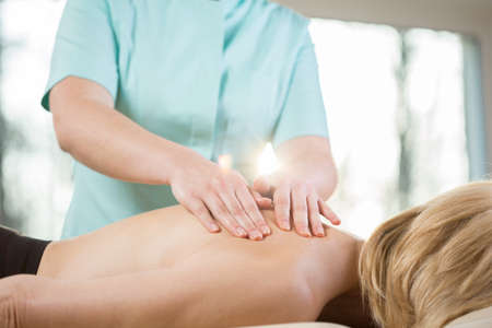 spinal manipulation: Close-up of physiotherapist stroking the skin during patients massage