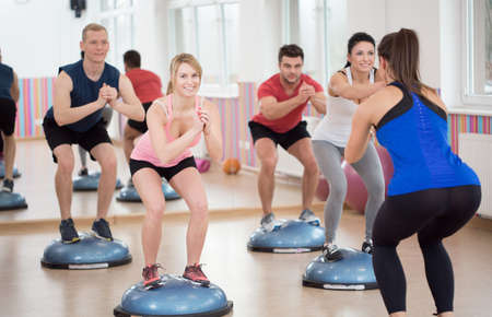 fitness instructor: Group of people during balance training, horizontal