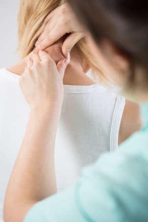 human spine: Close-up of manipulation of womans cervical spine