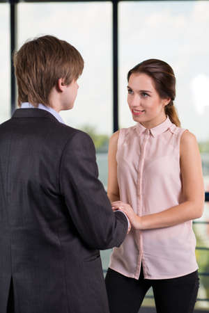 flirting: Beauty businesswoman flirting with coworker during break