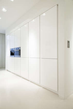 contemporary kitchen: White gleaming cupboards in contemporary kitchen interior
