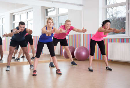pilates ball: Group of people exercising in pilates room Stock Photo