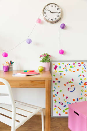 Colorful children study room with wooden desk and magnetic board Stock Photo