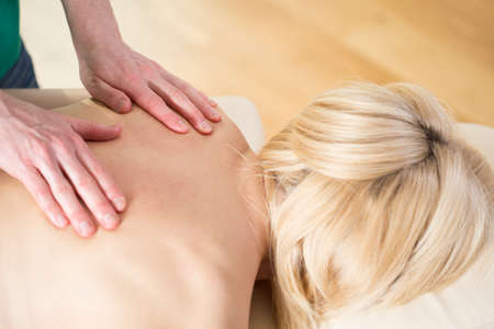 physiotherapists: Woman at physiotherapists office having massage