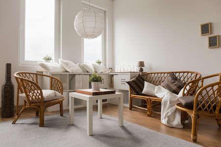 Wicker sofa and chairs in living room Zdjęcie Seryjne - 42426056