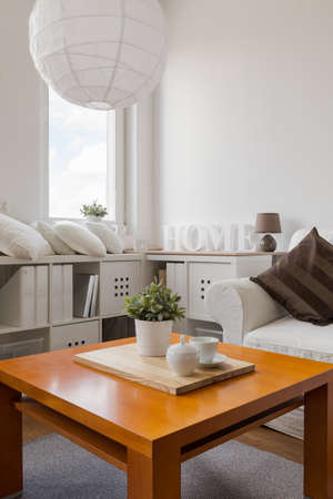 drawing room: Wooden coffee table in modern living room Stock Photo