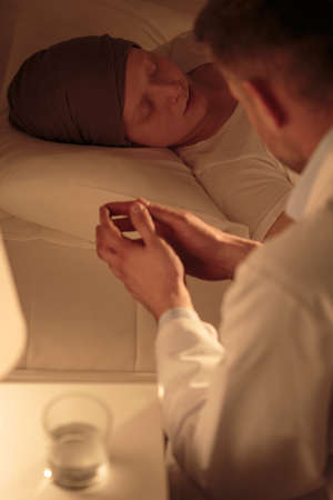 Worried oncologist spending night at hospital by his sick patient