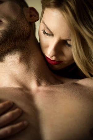 Woman kissing lovers neck during romantic foreplay