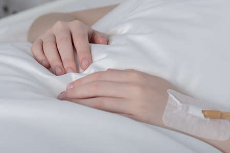 venous: Close-up of sick girls hands with peripheral venous line Stock Photo