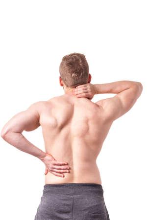 columna vertebral: Hombre musculoso joven que sufre de dolor de espalda