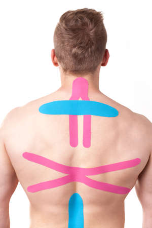 spinal disks: Kinesiotaping, kinesiology tape - application for back pain Stock Photo