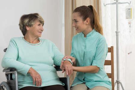 dignity: Portrait of professional carer nursing elderly disabled lady Stock Photo