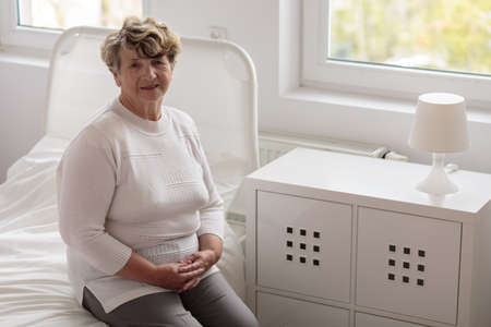 first day: Elegant elderly lady and her first day in hospital Stock Photo