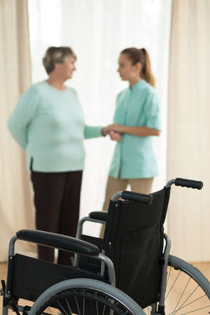 senescence: Photo of old lady and nurse in rest home Stock Photo