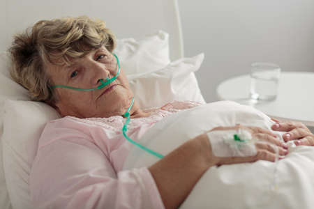 Aged woman with serious disorder of respiratory system