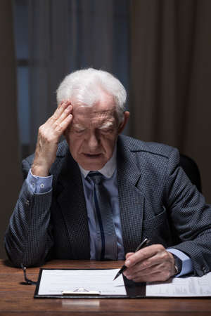 old document: Man is concentrated on business documents Stock Photo