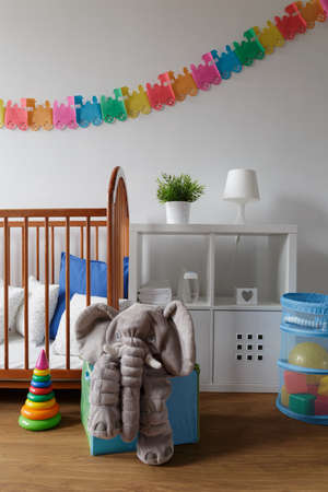 cosy: Picture of light and cosy newborn room with wall decoration Stock Photo