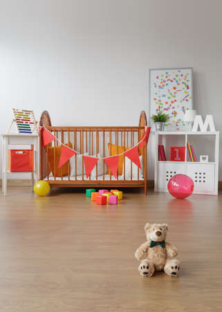 Photo of spacious child room interior with toys