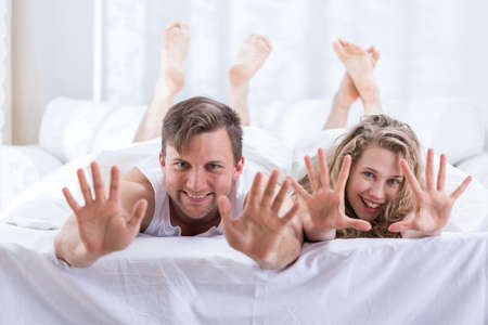 nude wife: Image of romantic happy couple having fun in bed Stock Photo
