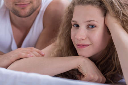 intimate sex: Portrait of young woman in love lying beside her boyfriend Stock Photo
