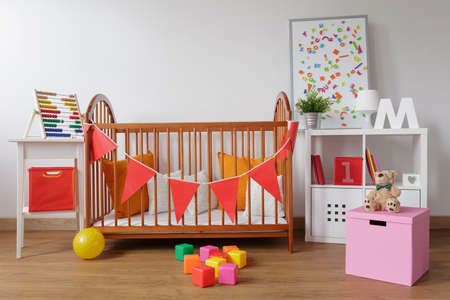 in a room: Photo of stylish room for babygirl with wooden crib