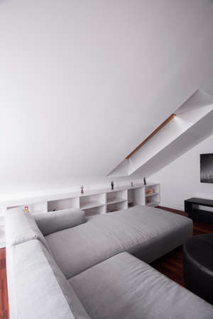 comfortable: Comfortable sofa in attic room in modern residence Stock Photo