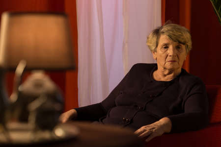 lonely woman: Elderly lady having her head full of worries