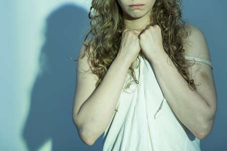 Close-up of young female victim of rape Stock Photo