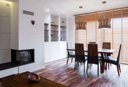 residence: Fireplace in wooden living room in residence