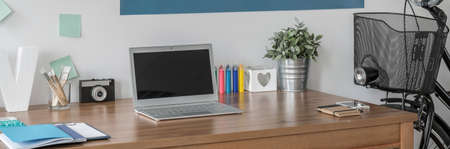 desk area: Panorama of study area with simple wooden desk Stock Photo