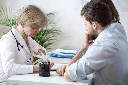office uniform: Couple with health problems at doctors office