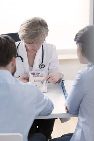in vitro: Gynecologist explaining in vitro process in modern way Stock Photo