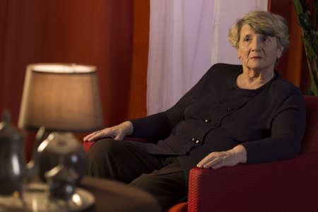 melancholic: Lonely elderly lady being in the melancholic mood