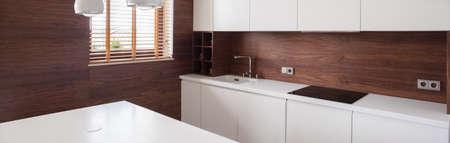 kitchen furniture: Wooden walls and white furniture in modern kitchen