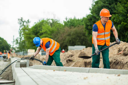labour: Image of construction workers during their work Stock Photo