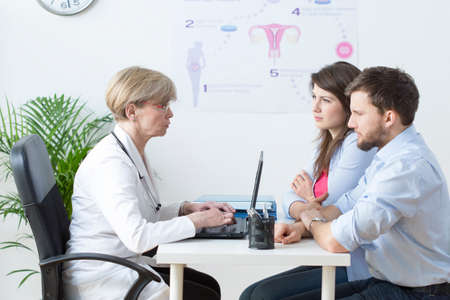Image of young couple visiting a gynecologist Stock Photo