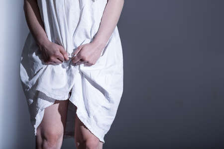 harassment: Innocent victim of rape in white sheet Stock Photo