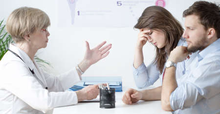 sorrowful: Image of sorrowful young marriage at gynecologists office Stock Photo