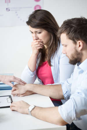 infertile: Image of prostrate infertile couple visiting gynecologist Stock Photo
