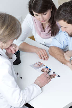 Young marriage deciding about appearance of baby Stock Photo