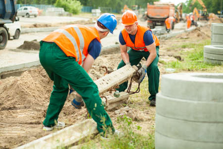 carry on: Men working at road construction in the city