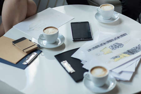business supplies: Coffee and business supplies on the table Stock Photo