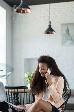 Beauty mulatto woman talking on the phone Stock fotó