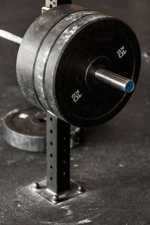 heavy weight: Close-up of heavy barbell weight at the gym
