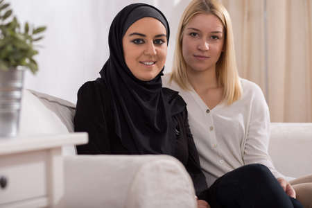 fille arabe: Pretty blond catholic girl and beautiful muslim in hijab